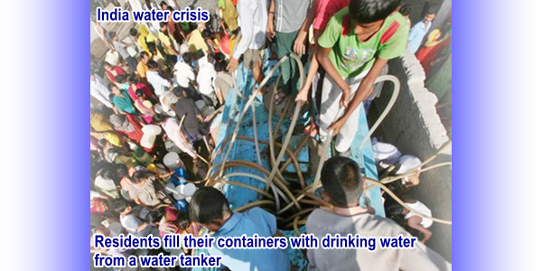 India Water Crisis:Residents fill their containers with drinking water from a water tanker