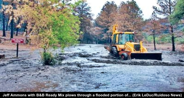 Bonito Lake ruined Jeff Ammons with B&B Ready Mix plows through a flooded portion Erik LeDuc Ruidoso News, drinking water contaminated