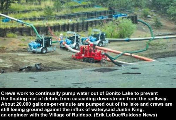 Crews work to continually pump water out of Bonito Lake