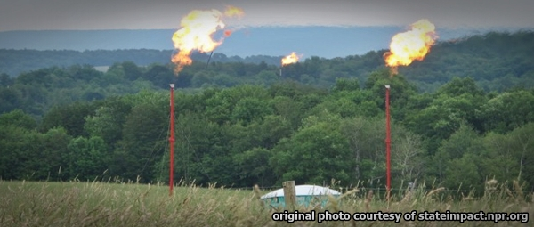 Methane gas burning off at fracking site. Click to enlarge.