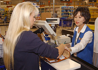 Studies show cashiers handling receipts have elevated levels of BPA.  Photo courtesy of USNavy/Wikimedia Commons
