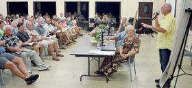 Carl Berg of the Surfrider Foundation Kauai Chapter leads a portion of Thursday's public meeting in Koloa, hosted by Friends of Mahaulepu, concerning Hawaii Dairy Farms' proposed 578-acre dairy. (Photo credit: Chris D'Angelo / The Garden Island)