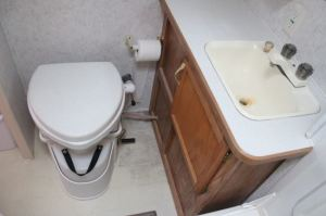 Nature's Head Composting Toilet: This composting toilet, in the intern's RV, has worked out