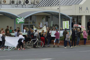 Anti-mining protesters outside the Hauraki District Council building in Paeroa yesterday.