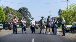 Gundaroo residents who oppose two proposals for residential development on either side of the village, standing on the main road. (Photo credit: Rohan Thomson)