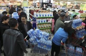 Many consumers in China rely on bottled water due to high levels of pollution in waterways. (Photo credit: Reuters pic, December 8, 2014)
