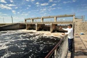 Eugene Little from Gainesville, Florida casts his line as he fishes in the spillway of the Senator George Kirkpatrick dam that controls the water level of the Rodman Reservoir. (Photo credit: Bob.Self@jacksonville.com)