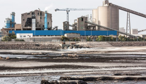 A view of a phosphate refinery in port city of Gabes, Tunisia, shows waste being dumped directly into the Mediterranean, April 15, 2014. (Photo credit:  Nicholas Linn)