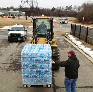 A spill of between 600 and 800 gallons of diesel fuel from property owned by the private utility that treats Hopewell's water closed the treatment plant and caused a shortage of water. Bottles and tankers of water were being delivered to Carter Woodson Middle Schoola and Hopewell High School for distribution on Tuesday, March 3, 2015.  (Photo credit: MARK GORMUS/TIMES-DISPATCH)