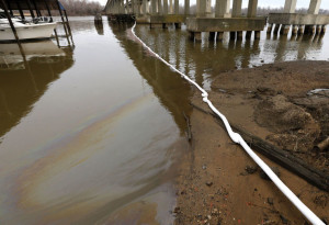 An oil sheen can be seen along a boom set up under Route 10 bridge into Hopewell, March 3, 2015. (Photo credit: JOE MAHONEY/times-dispatch)
