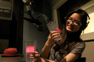 After teens noticed a change in the tap water in Oakland due to the California drought, 17-year-old Amber Lee took a tap vs. bottled water taste test in Youth Radio's studios. (Photo credit: Jenny Bolario/Youth Radio)