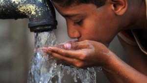 A Pakistani child drinks water from a hand-pump in an impoverished neighbourhood of Karachi on March 22, 2011, on World Water Day. According to UNICEF as many as 60 million people may not have access to safe drinking water, while more than 100,000 child deaths may be attributed to drinking unsafe water each year in Pakistan. AFP PHOTO/RIZWAN TABASSUM (Photo credit should read RIZWAN TABASSUM/AFP/Getty Images)