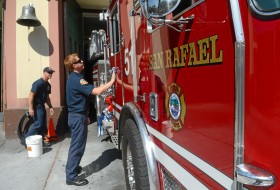 San Rafael firefighters Graham Winkelman and Mike Wasdyke clean a truck at the downtown fire station on C Street. The department uses a solution that does not require heavy rinsing. (Photo credit: Alan Dep/Marin Independent Journal)